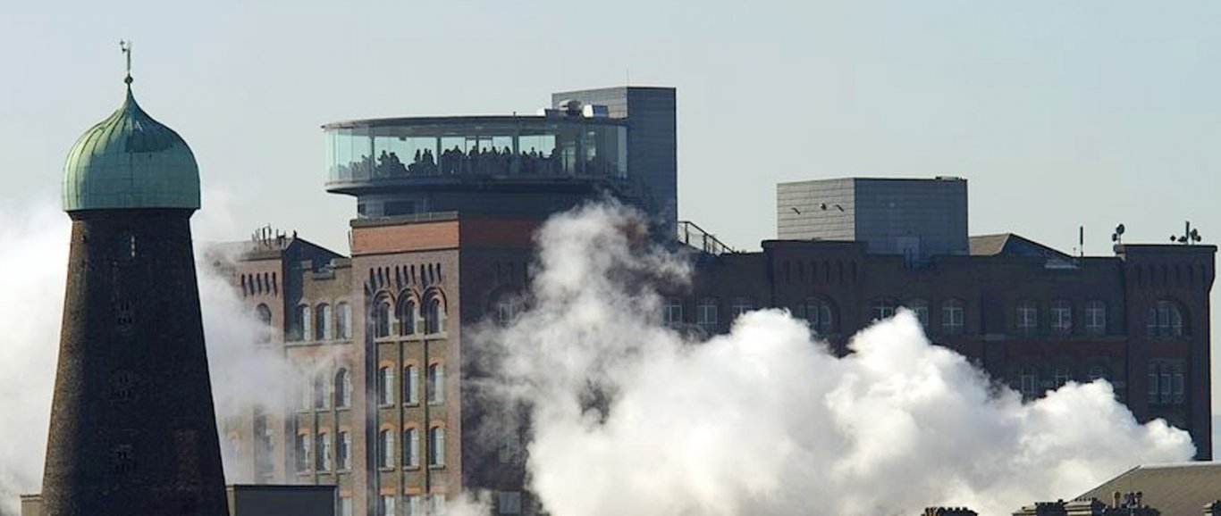Guinness storehouse with steam from the factory