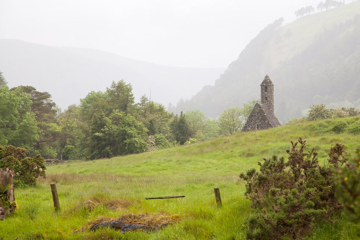 Field and Valley In Glendalough with Church and Round Tower