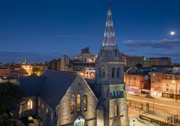 Pearse Lyons Whiskey Distillery at Night-time with glass steeple